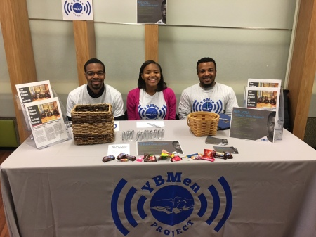 GendHR Lab members (l-r) Reginald Hammond Jr., Janelle Goodwill, and Ed-Dee Williams at Washtenaw Community College recruiting for the YBMen Project.