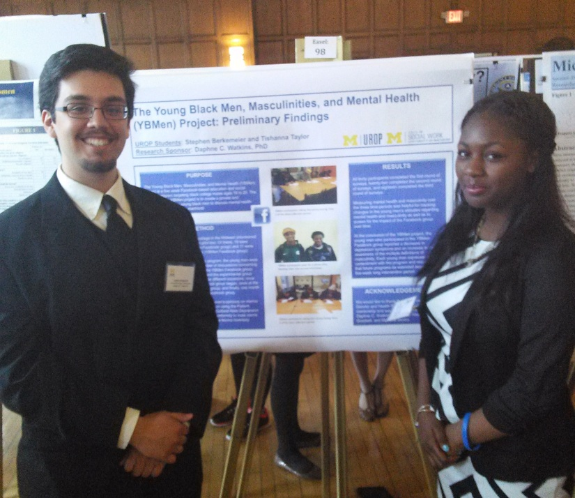UROP students Stephen Berkemeier and Tishanna Taylor smile next to their poster at the annual UROP symposium at U-M.